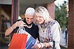 Older women examining shopping bags