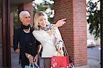 Older women carrying shopping bags
