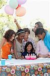 Children at birthday party with birthday cake