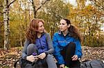 Young friends in sportswear in forest