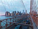 View of Lower Manhattan from Brooklyn Bridge at sunset in winter, New York City, New York, USA