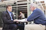 Businessmen meeting in cafe