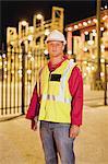 Worker wearing hardhat in shipyard