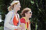 Girls walking in park together
