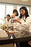 Scientist heating liquid in beaker