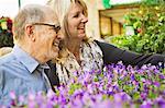 Older couple admiring flowers