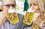 Older couple drinking beer together