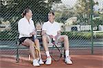 Older couple talking on park bench
