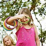Girl throwing rings outdoors