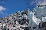 Hikers admiring glacial landscape