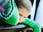 Girl leaning over banister