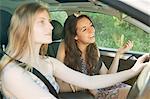 Teenage girls driving car