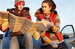 Women reading map by car