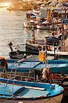 Boats docked in urban pier