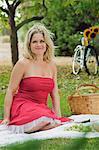 Woman sitting on picnic blanket