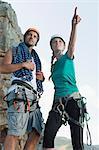 Climbers surveying mountaintop