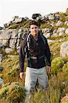 Hiker standing in rocky field