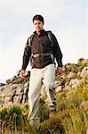Man hiking in rocky field
