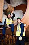 Workers talking in propeller on dry dock