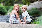 Children sitting on rock together