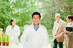 Scientist standing in meeting outdoors