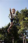 Teenage boy pointing in mid-air