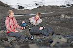 Couple having coffee in snowy landscape