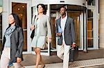 Business people walking on steps