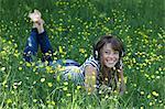 Woman listening to headphones in grass