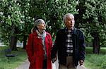 Older couple walking in park