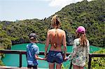 Family overlooking tropical ocean