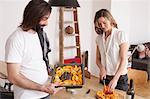 Couple preparing pumpkin dish at home