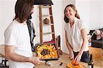 Smiling couple preparing pumpkin dish at home