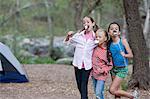 Portrait of three children eating toasted marshmallows whilst camping, Sedona, Arizona, USA