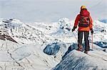 Mature female climber on glacier, Svinafellsjokull, Vatnajokull National Park, Iceland