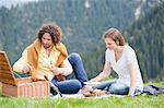 Mid adult couple unpacking picnic, Wallberg, Tegernsee, Bavaria, Germany