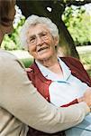 Senior woman looking at granddaughter