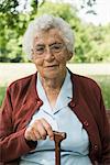 Portrait of senior woman, holding walking stick