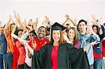 Crowd cheering behind confident graduate