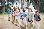 Children smiling at start of sack race