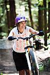 Girl pushing mountain bike