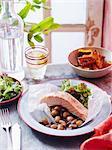 Salmon, pumpkin  and olive salad