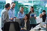 Businesspeople meeting around desk