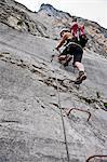 Female climber on rungs of via ferrata Che Guevara, Monte Casale, Trentino, Italy