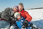 Family in winter, smiling, Bavaria, Germany