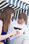 Couple toasting wine glasses, smiling