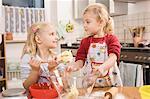 Girls preparing cookies, smiling
