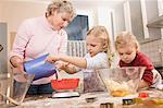 Family preparing cookies in kitchen