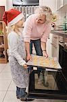 Grandother and granddaughter preparing cookies