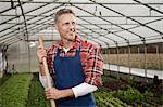 Smiling man in greenhouse